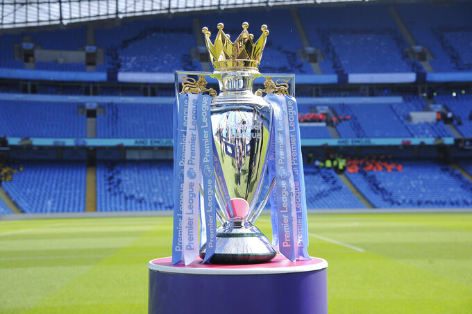 FILE - In this Sunday, May 6, 2018 file photo the English Premier League trophy sits on the pitch prior to the English Premier League soccer match between Manchester City and Huddersfield Town at Etihad stadium in Manchester, England. Matches in England will be stopped until at least April 3 after five Premier League clubs said some players or staff were in self-isolation. Arsenal manager Mikel Arteta has tested positive for the virus, as has Chelsea winger Callum Hudson-Odoi. (AP Photo/Rui Vieira, File)