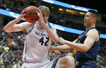 UC Irvine forward Tommy Rutherford, left, pulls down a rebound against Cal State Fullerton forward Johnny Wang, right, during the second half of an NCAA college basketball game for the Big West men's tournament championship in Anaheim, Calif., Saturday, March 16, 2019. UC Irvine won 92-64. (AP Photo/Alex Gallardo)