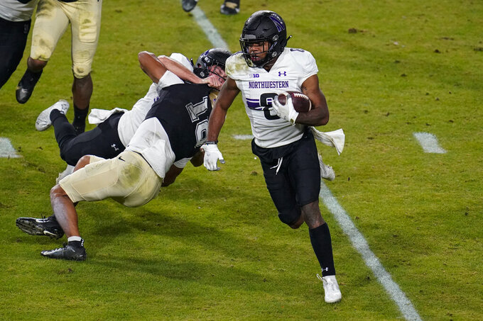 Northwestern wide receiver Kyric McGowan (8) runs against Purdue during the first half of an NCAA college football game in West Lafayette, Ind., Saturday, Nov. 14, 2020. (AP Photo/Michael Conroy)
