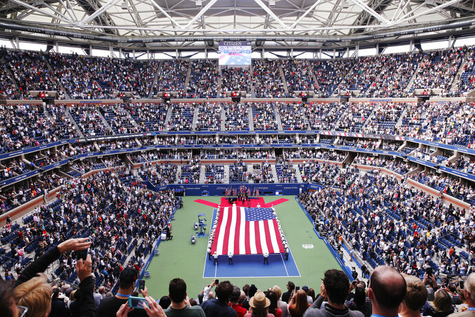 FILE - In this Sept. 10, 2017, file photo, Cadets from the West Point military academy present the American flag across the court at Arthur Ashe Stadium before the start of the men's singles final of the U.S. Open tennis tournament between Rafael Nadal, of Spain, and Kevin Anderson, of South Africa in New York. Play begins Aug. 26 at the U.S. Open, the year's last Grand Slam tennis tournament. Naomi Osaka and Novak Djokovic are the defending champions. (AP Photo/Seth Wenig, File)