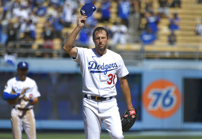 Los Angeles Dodgers Max Scherzer tips his cap after he pitched his 3000th career strikeout against San Diego Padres first baseman Eric Hosmer in the fifth inning during in a baseball game Sunday, Sept. 12, 2021, in Los Angeles, Calif. (AP Photo/John McCoy)