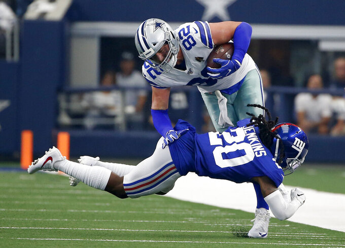 New York Giants cornerback Janoris Jenkins (20) stops Dallas Cowboys tight end Jason Witten (82) atfer Witten caught a pass in the first half of a NFL football game in Arlington, Texas, Sunday, Sept. 8, 2019. (AP Photo/Ron Jenkins)