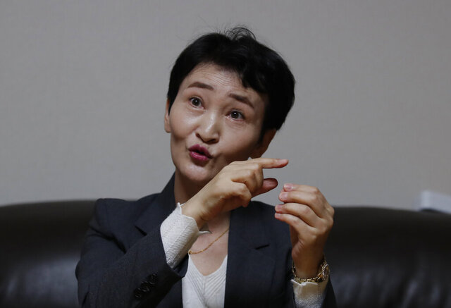 North Korean defector Kang Mi-Jin speaks during an interview in Seoul, South Korea, Tuesday, Nov. 3, 2020. Before fleeing authoritarian North Korea in 2009, Kang was regularly mobilized by the state for military-like productivity campaigns that were a source of both pride and pain. She was happy to be chosen to give a speech pledging loyalty to the ruling Kim family; less so when a tunneling construction project left her with a big scalp laceration. (AP Photo/Lee Jin-man)