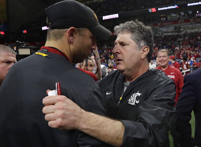 Washington State coach Mike Leach, right, and Iowa State coach Matt Campbell meet at midfield after the Alamo Bowl NCAA college football game, Friday, Dec. 28, 2018, in San Antonio. Washington State won 28-26. (AP Photo/Eric Gay)