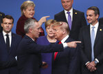 FILE - In this Dec. 4, 2019, file photo, NATO Secretary General Jens Stoltenberg, center front left, speaks with U.S. President Donald Trump, center front right, after a group photo at a NATO leaders meeting at The Grove hotel and resort in Watford, Hertfordshire, England. From left, French President Emmanuel Macron, Norway's Prime Minister Erna Solberg, German Chancellor Angela Merkel, Poland's President Andrzej Duda and Greek Prime Minister Kyriakos Mitsotakis. People have taken to the streets around the world to demonstrate in support of Black Lives Matter protesters in the United States and to vent anger over Trump's response to the police killing of George Floyd. But leaders of traditional allies of the United States have taken pains to avoid criticizing Trump directly. (AP Photo/Francisco Seco, File)