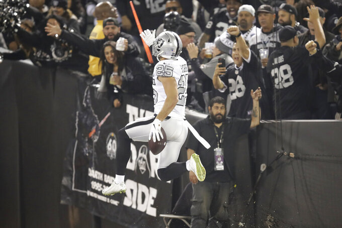 Oakland Raiders free safety Erik Harris (25) celebrates after scoring on an interception return against the Los Angeles Chargers during the first half of an NFL football game in Oakland, Calif., Thursday, Nov. 7, 2019. (AP Photo/Ben Margot)