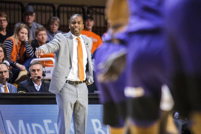 Oklahoma State coach Mike Boynton calls a play during the team's NCAA college basketball game against TCU on Wednesday, Feb. 5, 2020, in Stillwater, Okla. (Devin Lawrence/Tulsa World via AP)