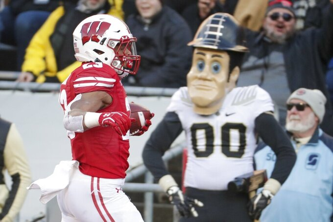 Wisconsin's Jonathan Taylor runs for a touchdown during the first half of an NCAA college football game against PurdueSaturday, Nov. 23, 2019, in Madison, Wis. (AP Photo/Morry Gash)