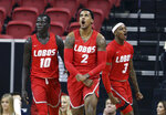 New Mexico's Caleb Martin, (10) Corey Henson (2) and Keith McGee (3) react after Henson scored during the first half of an NCAA college basketball game against Utah State in the Mountain West Conference men's tournament Thursday, March 14, 2019, in Las Vegas. (AP Photo/Isaac Brekken)
