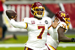 FILE - In this Sept. 20, 2020, file photo, Washington Football Team quarterback Dwayne Haskins (7) throws during the first half of an NFL football game against the Arizona Cardinals in Glendale, Ariz. The Pittsburgh Steelers signed the former Washington quarterback to a futures contract on Thursday, Jan. 21, 2021, giving the 23-year-old a second chance after the flamed out in the nation's capital in less than two seasons.  (AP Photo/Ross D. Franklin, File)