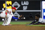 Detroit Tigers' Niko Goodrum, right, is caught stealing second by Cesar Hernandez during the sixth inning of a baseball game, Wednesday, May 1, 2019, in Philadelphia. (AP Photo/Matt Rourke)