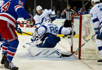 The puck drifts past Tampa Bay Lightning goalie Andrei Vasilevskiy in the second period after a shot by New York Rangers Boo Nieves that tied the game 3 to 3 during an NHL hockey game Wednesday, Feb. 27, 2019, at Madison Square Garden in New York. (AP Photo/Craig Ruttle)