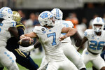 North Carolina quarterback Sam Howell (7) throws from the pocket during the second half of an NCAA college football game against Georgia Tech Saturday, Sept. 25, 2021, in Atlanta. (AP Photo/John Bazemore)