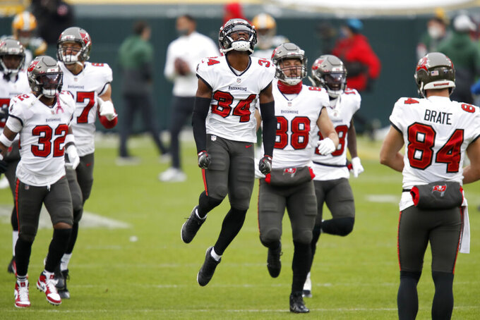 Tampa Bay Buccaneers' Javon Hagan (34) leaps as his team takes to field before the NFC championship NFL football game between the Tampa Bay Buccaneers and Green Bay Packers in Green Bay, Wis., Sunday, Jan. 24, 2021. (AP Photo/Matt Ludtke)