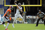 Jacksonville Jaguars quarterback Trevor Lawrence, right, throws a pass against the Denver Broncos during the first half of an NFL football game, Sunday, Sept. 19, 2021, in Jacksonville, Fla. (AP Photo/Phelan M. Ebenhack)