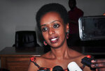 Diane Rwigara, the country's most prominent opposition figure, speaks to the media after being acquitted of charges related to her election challenge of President Paul Kagame, at the high court in Kigali, Rwanda Thursday, Dec. 6, 2018. Rwanda's high court on Thursday acquitted Rwigara of all charges, as judges said the prosecution failed to provide proof of insurrection and forgery. (AP Photo)