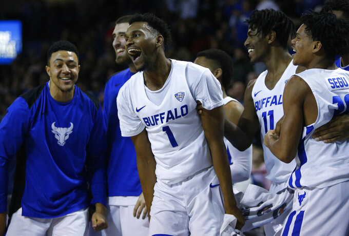 Buffalo forward Montell McRae (1) celebrates with teammates during the second half of an NCAA college basketball game against Eastern Michigan, Friday, Jan. 18, 2019, in Buffalo N.Y. (AP Photo/Jeffrey T. Barnes)