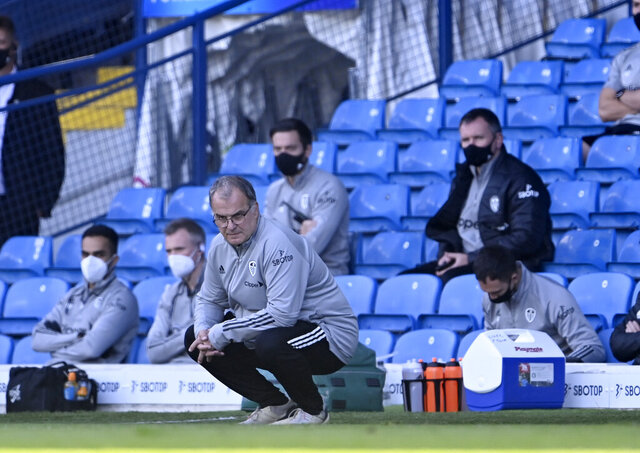 Leeds United's head coach Marcelo Bielsa looks out during the English Premier League soccer match between Leeds United and Fulham at Elland Road Stadium, in Leeds, England, Saturday, Sept. 19, 2020. (Laurence Griffiths/Pool via AP)