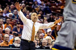 Texas head coach Shaka Smart gives instructions to the team during an NCAA college basketball game against West Virginia in Austin, Texas, Monday, Feb. 24, 2020. (Lola Gomez/Austin American-Statesman via AP)
