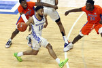 Kentucky's Davion Mintz (10) drives near Florida's Scottie Lewis (23) and Osayi Osifo (15) during the second half of an NCAA college basketball game in Lexington, Ky., Saturday, Feb. 27, 2021. (AP Photo/James Crisp)