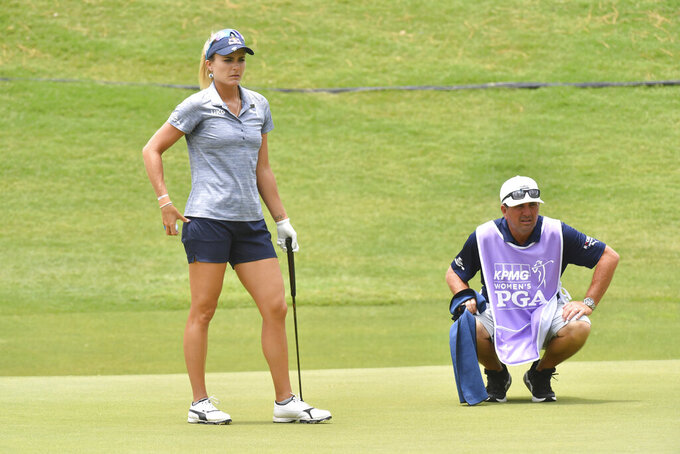 Lexi Thompson lines up a putt on the 16th green during the first round of the Women's PGA Championship golf tournament at Atlanta Athletic Club in Johns Creek, Ga. Thursday, June 24, 2021. (Hyosub Shin/Atlanta Journal-Constitution via AP)