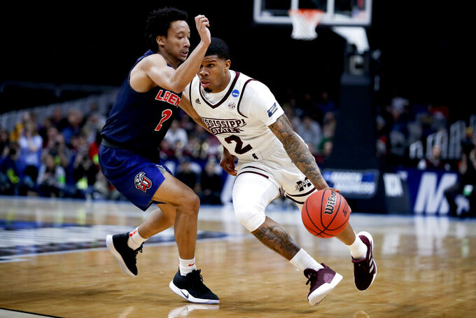 Mississippi State guard Lamar Peters, right, drives to the basket around Liberty guard Darius McGhee during the first half of a first-round game in the NCAA men's college basketball tournament Friday, March 22, 2019, in San Jose, Calif. (AP Photo/Ben Margot)