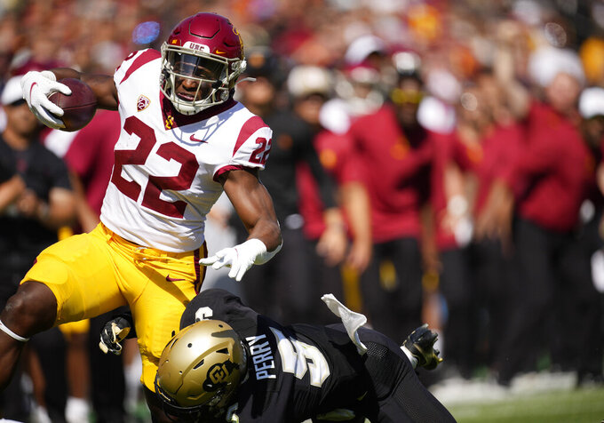 Southern California running back Darwin Barlow, left, rumbles for a gain as Colorado safety Mark Perry makes the tackle in the first half of an NCAA college football game Saturday, Oct. 2, 2021, in Boulder, Colo. (AP Photo/David Zalubowski)