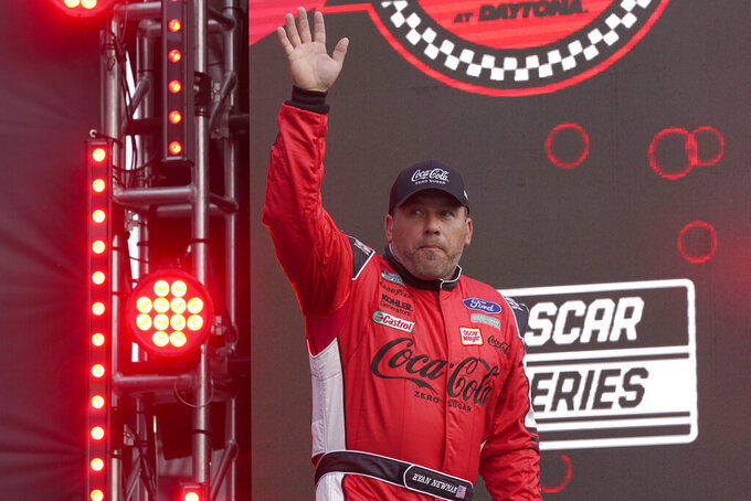 Ryan Newman waves to fans during driver introductions before the NASCAR Cup Series auto race at Daytona International Speedway, Saturday, Aug. 28, 2021, in Daytona Beach, Fla. (AP Photo/John Raoux)