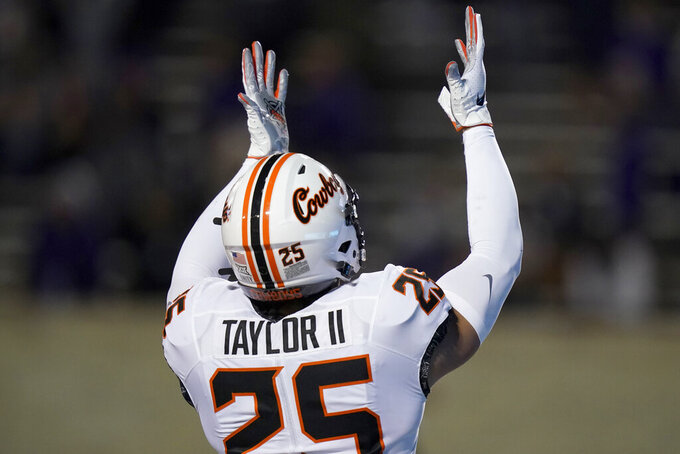 Oklahoma State safety Jason Taylor II (25) celebrates a touchdown during the second half of an NCAA college football game against Kansas State in Manhattan, Kan., Saturday, Nov. 7, 2020. Taylor returned a recovered fumble 85 yards. (AP Photo/Orlin Wagner)