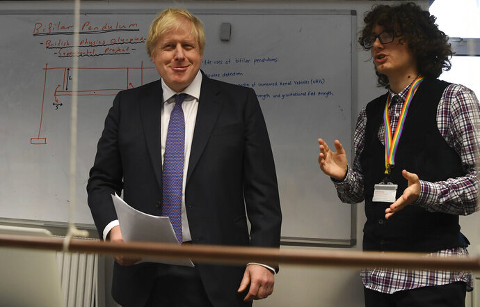Britain's Prime Minister Boris Johnson, center, visits the Department of Mathematics at King's Maths School, part of King's College London University, in London, Monday Jan. 27, 2020. (Daniel Leal-Olivas/Pool via AP)