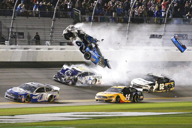 FILE - In this Feb. 17, 2020, file photo, Ryan Newman (6) goes airborne after colliding with Corey LaJoie (32) on the final lap of the NASCAR Daytona 500 auto race at Daytona International Speedway. Newman expects to get a little emotional when he drives into Daytona International Speedway this weekend. His last time through the famed track's tunnel came in the back of an ambulance--with countless onlookers fearing for his life.(AP Photo/Terry Renna, File)