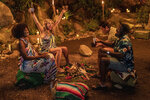 """This image released by Hulu shows Yvonne Orji, from left, Meredith Hagner, John Cena and Lil Rel Howery in a scene from """"Vacation Friends."""" (Jessica Miglio/20th Century Studios)"""