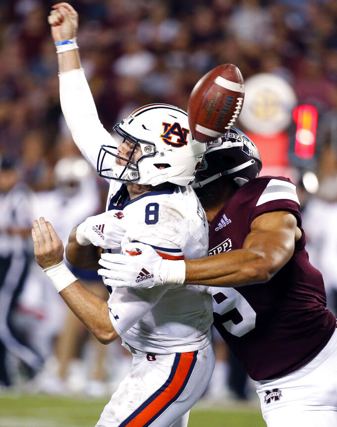 FILE - In this Saturday, Oct. 6, 2018, file photo, Mississippi State defensive end Montez Sweat (9) forces Auburn quarterback Jarrett Stidham (8) to fumble as he attempts to pass during the second half of their NCAA college football game in Starkville, Miss. No. 24 Mississippi State has some problems to fix during its off week, but they're mostly on the offensive end. The Bulldogs' defense has been elite and is giving up just 12.7 points per game, which ranks No. 1 in the country.  (AP Photo/Rogelio V. Solis, File)
