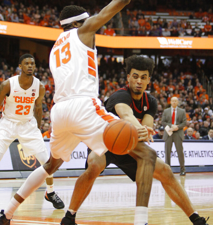 Louisville's Jordan Nwora, right, passes around Syracuse's Paschal Chukwu, left, during the first half of an NCAA college basketball game in Syracuse, N.Y., Wednesday, Feb. 20, 2019. (AP Photo/Nick Lisi)