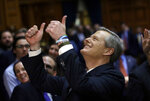 Massachusetts Gov. Charlie Baker gives a thumbs-up to people in the balcony audience of the House Chamber as he departs after delivering his state of the state address, Tuesday, Jan. 21, 2020, at the Statehouse, in Boston. (AP Photo/Steven Senne)