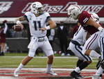 Connecticut quarterback Jack Zergiotis (11) throws during the first half of an NCAA college football game against Massachusetts, Saturday, Oct. 26,, 2019, in Amherst, Mass. (AP Photo/Jessica Hill)