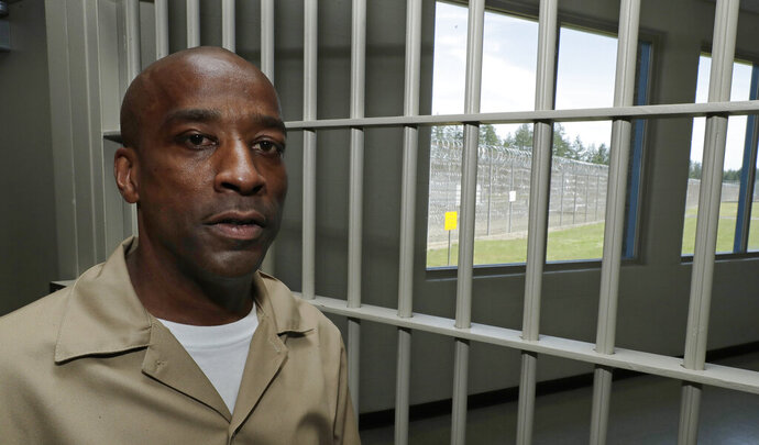 In this May 9, 2019 photo, Devon Laird poses for a photo in the Washington Correctional Center in Shelton, Wash. Laird is among a small group of inmates who are set to stay in Washington state prisons for life who were left out of the latest in a multi-year wave of reforms easing tough-on-crime