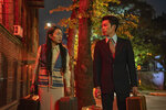 In this image released by Netflix, Kunjue Li , left, and Hong Chi appear in a scene from