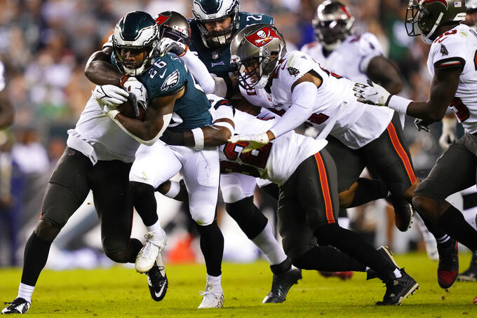 Philadelphia Eagles running back Miles Sanders (26) is tackled during the second half of an NFL football game against the Tampa Bay Buccaneers on Thursday, Oct. 14, 2021, in Philadelphia. (AP Photo/Matt Slocum)