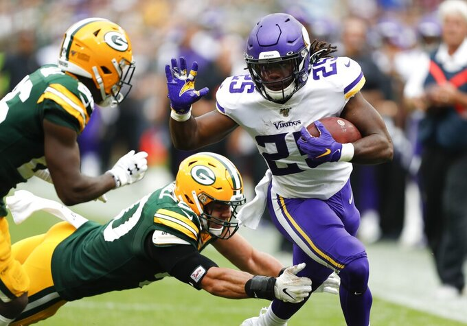 Minnesota Vikings' Alexander Mattison runs during the second half of an NFL football game against the Green Bay Packers Sunday, Sept. 15, 2019, in Green Bay, Wis. (AP Photo/Matt Ludtke)