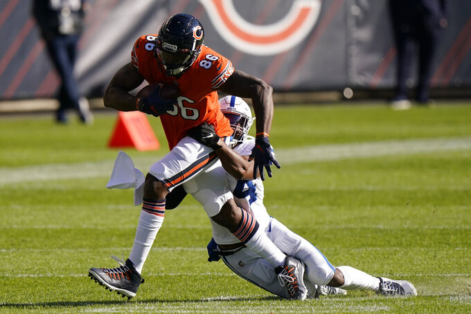 Chicago Bears' Demetrius Harris (86) is tackled by Indianapolis Colts' Anthony Walker (54) during the first half of an NFL football game, Sunday, Oct. 4, 2020, in Chicago. (AP Photo/Nam Y. Huh)