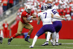 Wisconsin running back Jonathan Taylor (23) runs against Northwestern defensive back Travis Whillock (7) and linebacker Blake Gallagher (51) during the second half of an NCAA college football game Saturday, Sept. 28, 2019, in Madison, Wis. Wisconsin won 24-15. (AP Photo/Andy Manis)