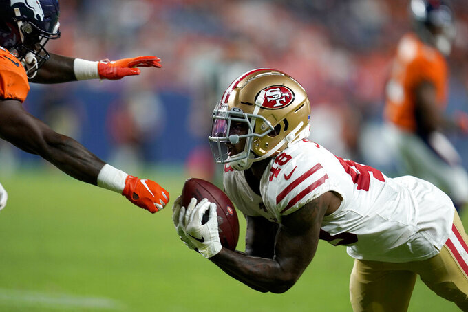 San Francisco 49ers defensive back Dontae Johnson (48) intercepts a pass intended for running back Dave Williams, left, during the second half of an NFL preseason football game, Monday, Aug. 19, 2019, in Denver. (AP Photo/Jack Dempsey)