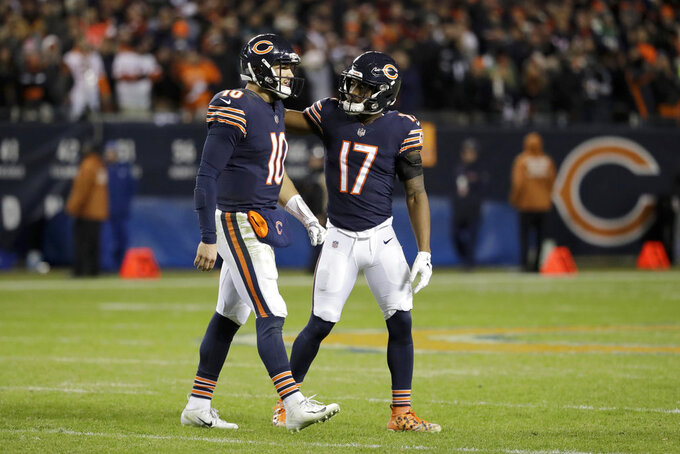 Chicago Bears quarterback Mitchell Trubisky (10) talks to wide receiver Anthony Miller (17) during the second half of an NFL wild-card playoff football game against the Philadelphia Eagles Sunday, Jan. 6, 2019, in Chicago. The Eagles won 16-15. (AP Photo/Nam Y. Huh)