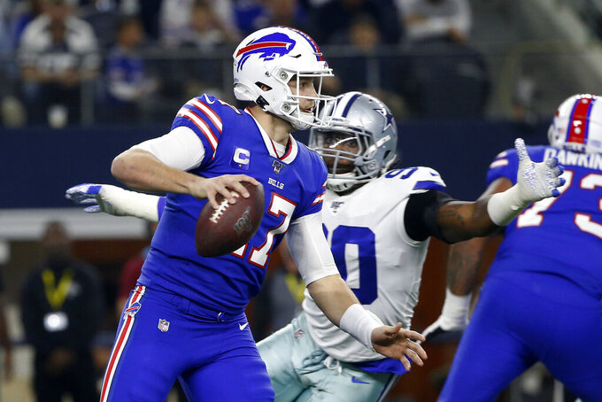 Buffalo Bills quarterback Josh Allen (17) is pressured out of the pocket by Dallas Cowboys defensive end DeMarcus Lawrence (90) in the first half of an NFL football game in Arlington, Texas, Thursday, Nov. 28, 2019. (AP Photo/Ron Jenkins)