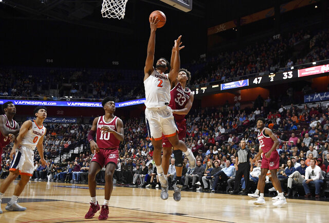 Virginia's Braxton Key (2) makes a basket as Massachusetts' Tre Mitchell (33) defends during the second half of an NCAA college basketball game, Saturday, Nov. 23, 2019, in Uncasville, Conn. (AP Photo/Jessica Hill)