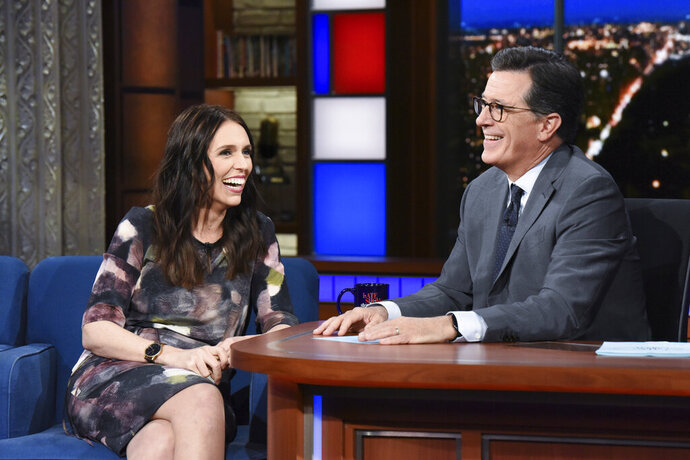 This Sept. 26, 2018 photo release by CBS shows New Zealand Prime Minister Jacinda Ardern, left, with host Stephen Colbert during a taping of