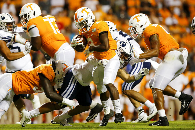 Tennessee running back Eric Gray (3) breaks a tackle attempt from BYU linebacker Jackson Kaufusi (38) during an NCAA football game at Neyland Stadium on Saturday, Sept. 7, 2019 in Knoxville, Tenn.(C.B. Schmelter/Chattanooga Times Free Press via AP)