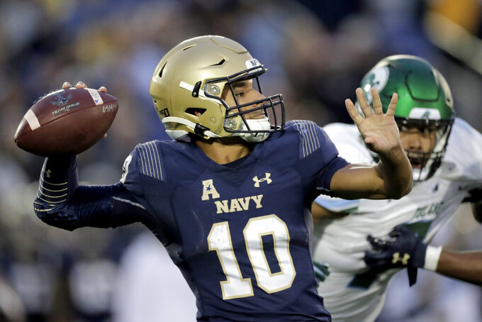 Navy quarterback Malcolm Perry throws a pass against Tulane during the second half of an NCAA college football game, Saturday, Oct. 26, 2019, in Annapolis. Navy won 41-38. (AP Photo/Julio Cortez)