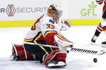 Calgary Flames goaltender David Rittich (33) deflects a shot during the second period of the team's NHL hockey game against the Carolina Hurricanes in Raleigh, N.C., Tuesday, Oct. 29, 2019. (AP Photo/Gerry Broome)
